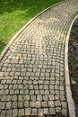Paved road outdoors photography of cobblestone sidewalk made of cubic stones Stock Photo