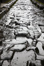 Paved street at the ancient roman city of pompei which was destroyed and buried during eruption mount vesuvius in ad Stock Photos