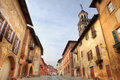 Paved street among historic houses in Saluzzo. Stock Photo