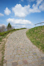 Paved way up the hill, with curve Royalty Free Stock Photo