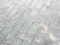Pavement background of grey cobble stones Royalty Free Stock Image