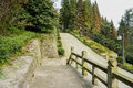 Pavement with balustrade by mountainside road in sunny afternoon stone dujiangyan china Stock Images