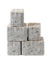 Pavement blocks three concrete block with mineral topping shot on white Stock Images