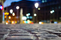 Pavement and blurred city light during night time Royalty Free Stock Photo