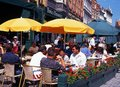 Pavement cafes bruges tourists relaxing at in the market place belgium western europe Royalty Free Stock Photos
