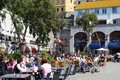 Pavement cafes gibraltar tourists relaxing at in grand casemates square united kingdom western europe Stock Photos
