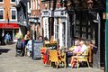 Pavement cafes shrewsbury people relaxing at along butcher row during the springtime shropshire england uk western europe Royalty Free Stock Photo