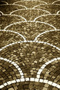 Pavement with cobblestones sepia hue a detail of a high contrast straight useful as a background portrait cut Royalty Free Stock Image