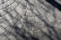 Pavement details texture made of stone blocks set up together in a circle Stock Photography