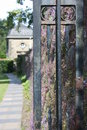 A pavement and the gate in glasgow s pollok country park rusted Royalty Free Stock Images
