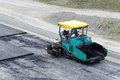 Pavement machine ready for laying fresh asphalt or bitumen Royalty Free Stock Image