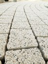 Pavement path laid from light creme concrete blocks with mineral topping Royalty Free Stock Photo