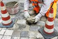 Pavement repairing urban stone by road worker Stock Photos