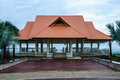 Pavilion with light orange roof the on the top of reclamation field mae moh mine thailand Stock Photo