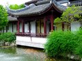 A pavilion near fish ponds an ancient with carps in the front in garden of shanghai china Royalty Free Stock Photo