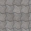 Paving slabs seamless tileable texture gray figured pavement as bending square small size Stock Images