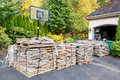 Paving stones delivered pallets of secured with wire and straps sit in the driveway Royalty Free Stock Photos