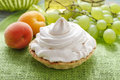 Pavlova cake with grapes and peaches Royalty Free Stock Photo