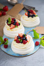 Pavlova cakes with cream and fresh berries Royalty Free Stock Photo