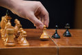 Pawn move the figures placed on the board a man s hand does Royalty Free Stock Photos