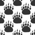 Paws, seamless vector, black animal footprints, dog, cat, bear Royalty Free Stock Photo