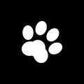 Paws vector icon isolated on black background.