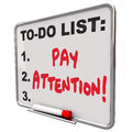 Pay attention message board attentive conscious awareness words written on a dry erase telling you to watch listen be and of a Royalty Free Stock Image