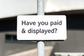 Pay and display carpark sign white metal car park with black text asking have you paid dispkayed on metal pole manchester uk Royalty Free Stock Photos