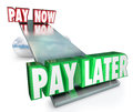 Pay now vs later delay payments borrow credit installment plan words on a see saw or balance to illustrate the choice and decision Stock Photos