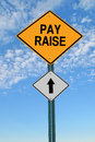 Pay raise ahead roadsign road sign over blue sky with clouds Stock Photo