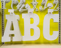 Pay for your education a b and c letters on a shelf ready purchase learn abcs Royalty Free Stock Photo
