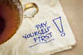 Pay yourself first advice a reminder of personal finance strategy a napkin doodle with a tea cup Stock Photos