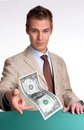 Paying cash young businessman agent giving one dollar bill Stock Photos