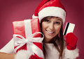 Paying for christmas gift santa woman with red box and credit card Royalty Free Stock Photo