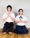 Paying obeisance of high school asian thai students lovers are Stock Images