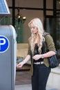 Paying at a parking meter Royalty Free Stock Photo