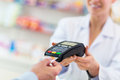Paying in the pharmacy customer through credit card Royalty Free Stock Photography