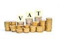 Paying vat value added tax on stacks of gold coins with isolated background Royalty Free Stock Image