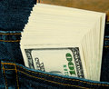 Payment pack of dollars in a jeans pocket Royalty Free Stock Images