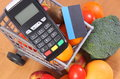 Payment terminal and credit card with fruits and vegetables, cashless paying for shopping, finance concept Royalty Free Stock Photo
