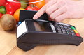 Payment terminal with credit card, fruits and vegetables, cashless paying for shopping Royalty Free Stock Photo