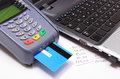 Payment terminal with credit card laptop and financial calculations reader finance concept Stock Photo
