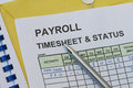 Payroll timesheet weekly with pen timekeeping record and Royalty Free Stock Photos