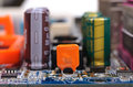 Pc mainboard part of with electronic components close up with selective focus and shallow dof Stock Images