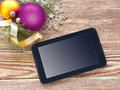 PC tablet screen on wood with xmas decoration. Royalty Free Stock Photo