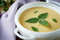 Pea cream soup with basil food close up Royalty Free Stock Photos