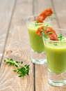 Pea soup close up of cold cream with bacon and thyme in portion glasses vertical Royalty Free Stock Images