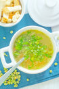 Pea soup with greens in a white bowl with a spoon Royalty Free Stock Photography