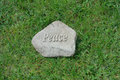 Peace carved garden stone rock in grass top shot of green Royalty Free Stock Images