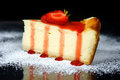 Peace of cheesecake with strawberry sauce Royalty Free Stock Photo